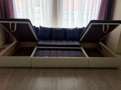 Модульный диван Кормак в разложенном виде фотографии ящиков для белья